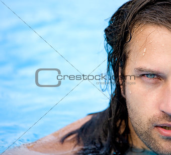 beautiful man in water pool
