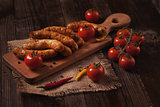 barbecue sausages on the wooden table