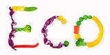eco inscription from pieces of vegetables on white background