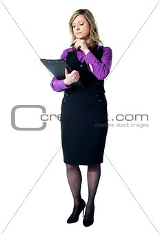 Corporate woman reading official documents
