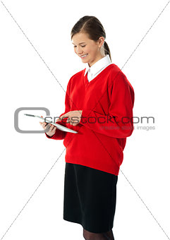 Beautiful teenage using electronic tablet