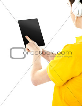 Boy operating touch pad device