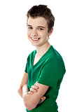 Young boy posing with folded arms