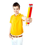 Stylish boy showing two large pencils