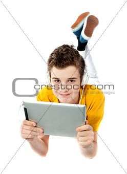 Boy lying on a floor with wireless device
