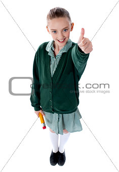 Attractive kid showing thumbs up