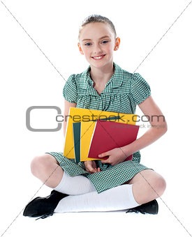 Beautiful girl holding school books
