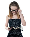 Beautiful girl reading book