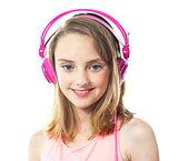 Attractive girl wearing pink headphones