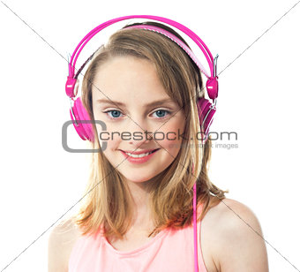 Attractive girl wearing pink headphones