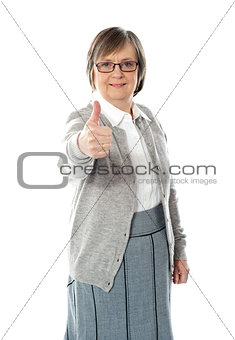 Old lady showing thumbs up gesture