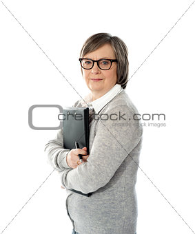 Aged woman holding business documents