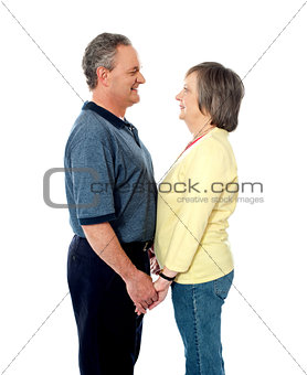 Aged couple in love holding hands