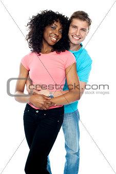 Boyfriend hugging his girl from behind