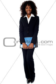 African businesswoman carrying documents
