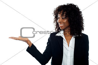 African woman with open palm. Copy space