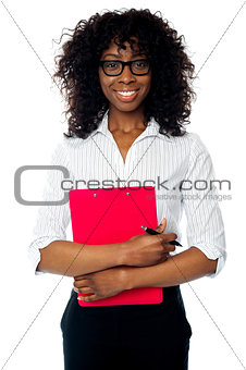 Corporate woman posing with clipboard and pen