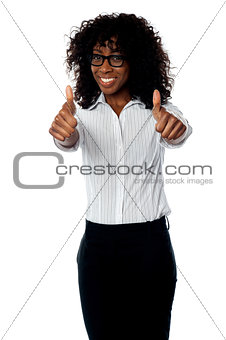 Corporate woman gesturing double thumbs up