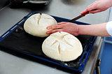Female cutting dough in a creative manner