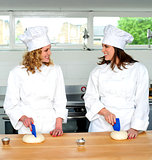 Two female chefs looking at each other