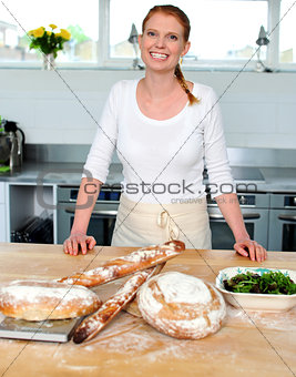 Attractive smiling female cook