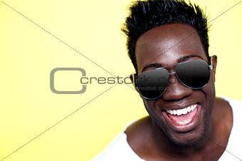 Closeup of joyful young african guy in sunglasses