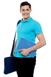 Smiling guy holding notepad and laptop bag