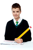School boy writing on notebook