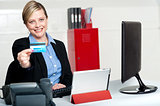 Beautiful corporate woman holding credit card