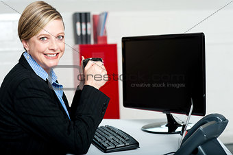 Corporate lady enjoying coffee during break