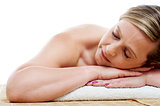 Cropped image of woman relaxing at spa centre