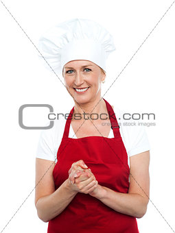 Beautiful female cook looking at you