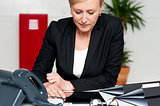 Female executive looking down at tablet screen