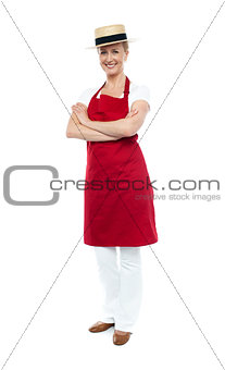 Beautiful confident chef posing in style, arms folded