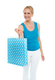 Shopping woman carrying bag, enjoying sale