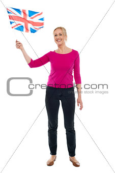 Aged patriotic lady waving United Kingdom flag