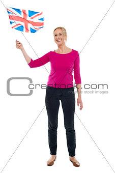Aged patriotic lady waving United Kingdom flag