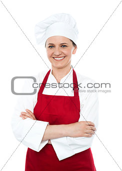 Portrait of smiling middle aged cook in uniform