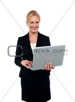 Corporate woman holding laptop