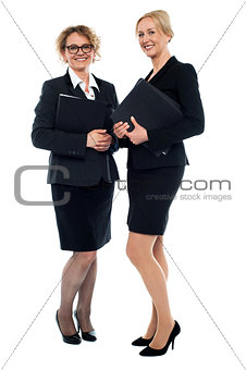 Aged businesswomen posing with documents