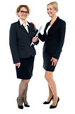 Full length shot of corporate female friends