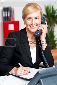 Corporate lady communicating on phone