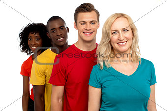 Group of cheerful teenagers standing in a line
