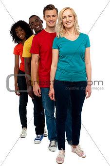 Friends standing behind beautiful caucasian woman