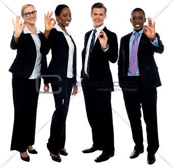 Successful corporate team showing ok symbol
