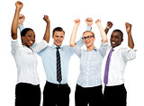 Business team of four celebrating success