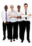 Young attractive business people. Arms folded