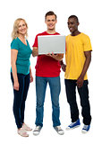 Full length shot of teenagers with laptop