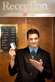 Snap shot of handsome guy holding cash card