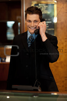 Calm and relaxed executive interacting over the phone